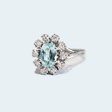 Bague marguerite de diamant et son coeur de topaze