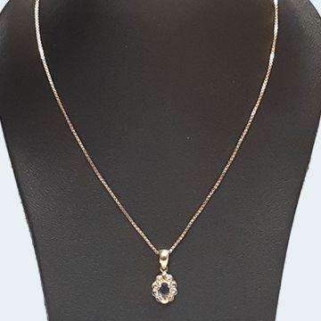 Collier en or avec pendentif marguerite et saphir